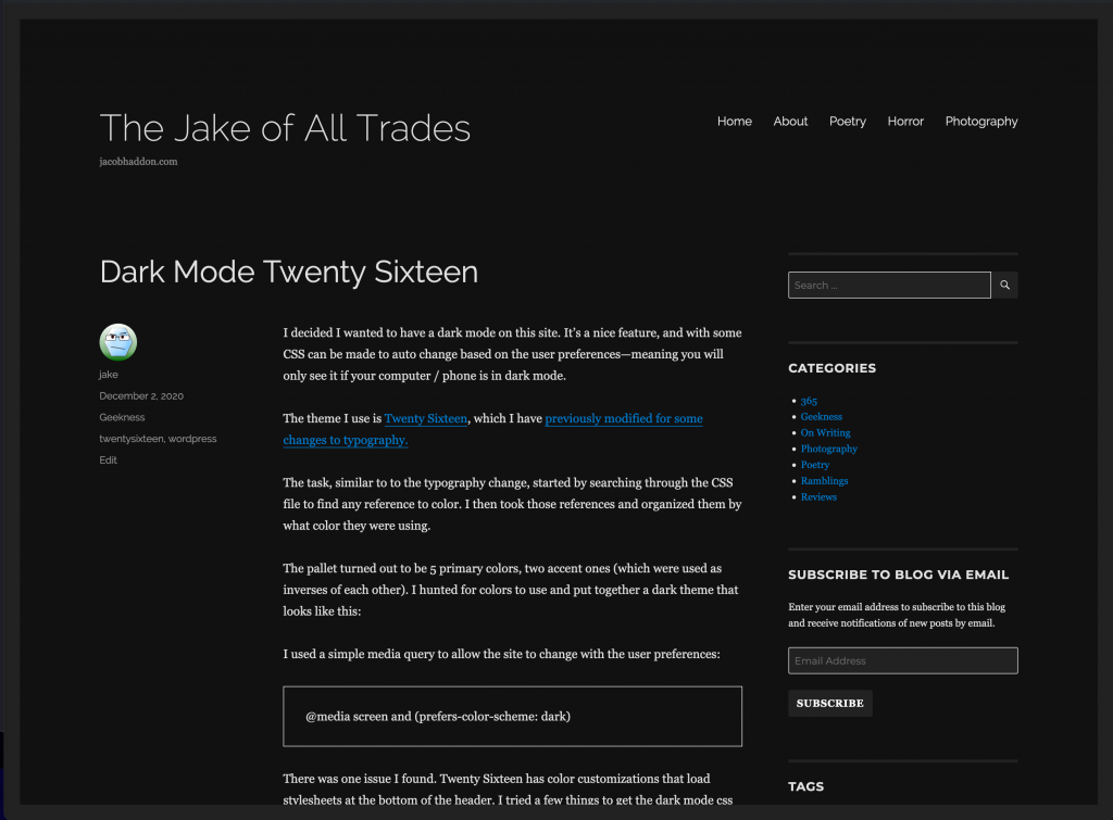 screenshot of this website with the dark mode theme active, background is black and dark grey, words are white and blue